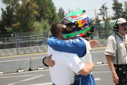 Pole winner Memo Rojas celebrates with Scott Pruett