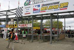 Fans enter the track