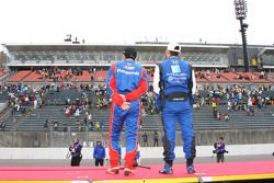 Roger Yasukawa and Hideki Mutoh announce to the fans that the race has been postponed to Sunday