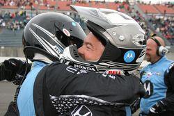 Andretti Green Racing crew members celebrate as Danica Patrick wins the Indy Japan 300