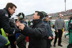 Danica Patrick's husband Paul and Michael Andretti celebrate as Danica Patrick wins the Indy Japan 3