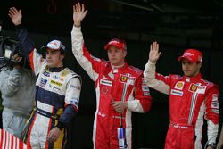 Pole winner Kimi Raikkonen with Fernando Alonso and Felipe Massa