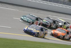 Michael Waltrip leads a group of cars