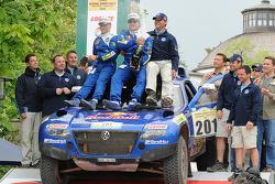 Finish podium: rally winners Carlos Sainz and Michel Périn