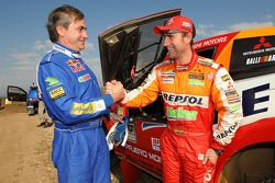 Rally winner Carlos Sainz celebrates with runner-up Stéphane Peterhansel