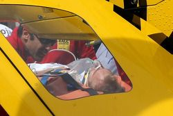 Heikki Kovalainen, McLaren Mercedes on a stretcher being loaded into a helicopter after crashing