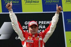 Podium: race winner Kimi Raikkonen celebrates