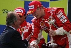 Podium: race winner Kimi Raikkonen receives the winner trophy from Juan Carlos I, King of Spain