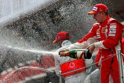 Podium: race winner Kimi Raikkonen sprays champagne