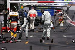 Fernando Alonso, Renault F1 Team comes bact to the pits after he stopped on the track
