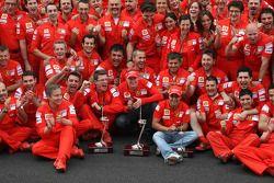 Kimi Raikkonen, Felipe Massa and Scuderia Ferrari team members celebrate win and second place