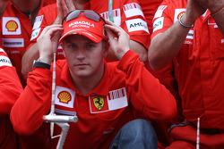 Kimi Raikkonen and Scuderia Ferrari team members celebrate win and second place