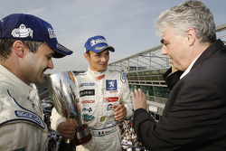 Podium: race winners Pedro Lamy and Stéphane Sarrazin celebrate with Peugeot CEO Jean-Philippe Collin