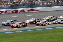 Tony Stewart and Mike Wallace lead a pack