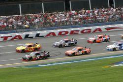 Kevin Harvick and Denny Hamlin lead a group of cars