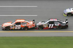 Tony Stewart gets a push from Denny Hamlin