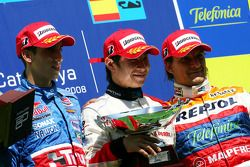 Podium: race winner Kamui Kobayashi with Sebastien Buemi and Giorgio Pantano