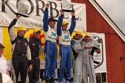 DP podium: class and overal winners Scott Pruett and Memo Rojas, second place Ryan Daziel and Henri