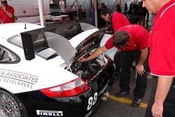 Technicians attend to the Farnbacher Loles Porsche GT3 Cup