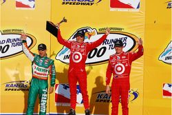 Podium: race winner Dan Wheldon with Tony Kanaan and Scott Dixon