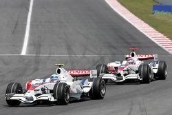 Anthony Davidson, Super Aguri F1 SA08A, leads team mate Takuma Sato, Super Aguri F1 SA08A