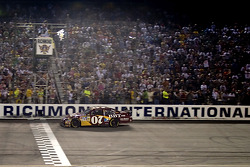 Clint Bowyer takes the checkered flag