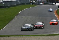Ralf Schumacher, Mücke Motorsport AMG Mercedes, AMG Mercedes C-Klasse leads Mike Rockenfeller, Audi