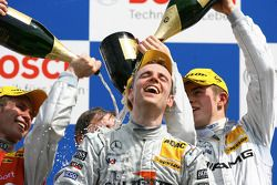 Podium: champagne for Jamie Green, Paul di Resta and Tom Kristensen