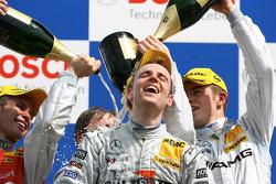 Podium: champagne for Jamie Green, Paul di Resta and Tom Kristensen