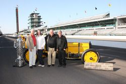 Rick Mears, Mari Hulman George, A.J. Foyt and Al Unser Sr. pose with the Borg Warner trophy and the