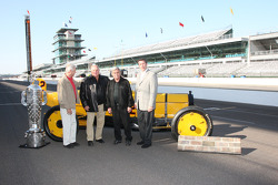 Rick Mears, Mari Hulman George, A.J. Foyt, Al Unser Sr. and Tony George pose with the Borg Warner trophy and the Marmon Wasp