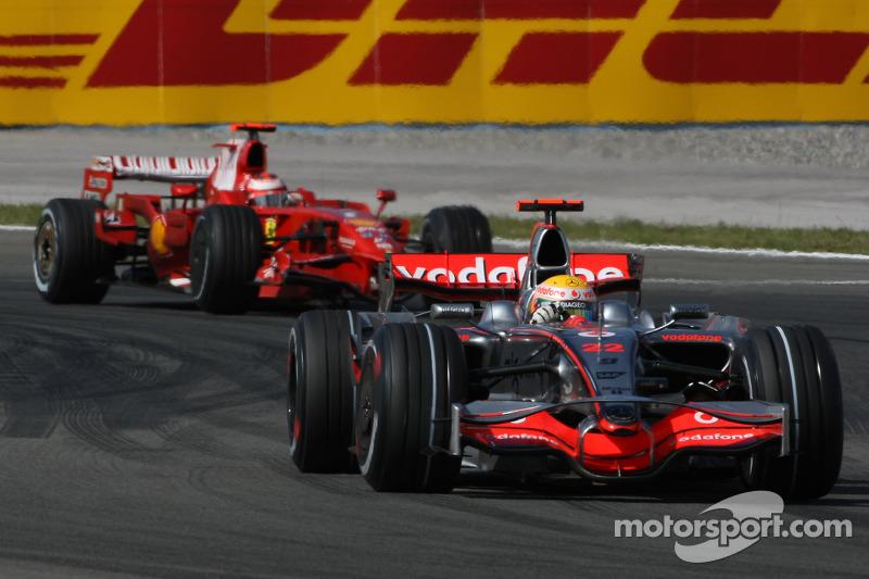Lewis Hamilton, McLaren Mercedes, MP4-23 ve Kimi Raikkonen, Scuderia Ferrari, F2008