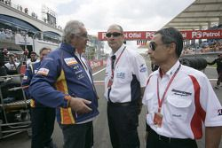 Flavio Briatore, Bruno Michel and Hiroshi Yasukawa on the starting grid