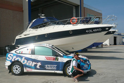 Gianluigi Galli poses with his car and a boat