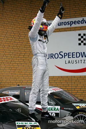 Race winner Paul di Resta celebrates