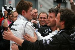 Race winner Paul di Resta celebrates with his team