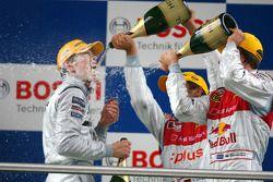 Podium: race winner Paul di Resta gets a champagne shower from Timo Scheider and Mattias Ekström