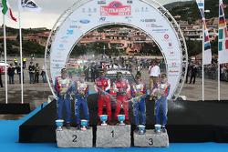 Podium: winners Sébastien Loeb and Daniel Elena, second place Mikko Hirvonen and Jarmo Lehtinen, third place Jari-Matti Latvala and Miikka Anttila