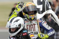 Valentino Rossi celebrates his 90th career victory and equals the record set by the great Angel Nieto who rides Rossi on a victory lap