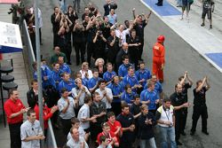 The teams applaud their drivers