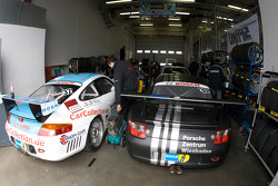 Porsche cars sit in the garage