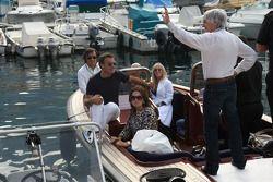 Bernie Ecclestone, President and CEO of Formula One Management, waving with Slavica Ecclestone, Wife to Bernie Ecclestone and Jean Alesi