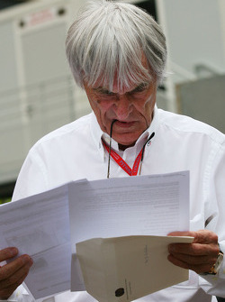 Bernie Ecclestone, President and CEO of Formula One Management reading a letter from the FIA