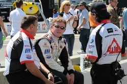 Andrew Prendeville talking with his crew members before the race