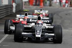 Kazuki Nakajima, Williams F1 Team leads Timo Glock, Toyota F1 Team