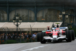 Timo Glock, Toyota F1 Team leads Jenson Button, Honda Racing F1 Team