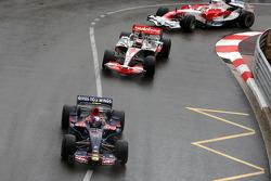 Sebastian Vettel, Scuderia Toro Rosso leads Heikki Kovalainen, McLaren Mercedes