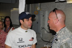 Vitor Meira talking with a soldier