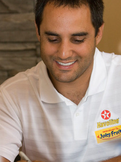 Juan Pablo Montoya with the Juicy Fruit Dodge Team signs a couple autographs for his fans during the Ganassi Fan Appreciation