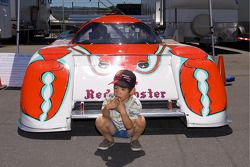 A a small boy immitates the Red Lobster Historic IMSA car